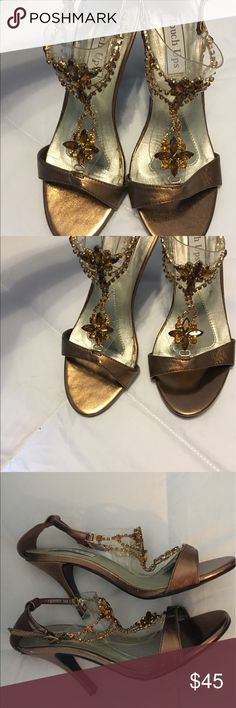 """Touch Ups Princess Bronze Rhinestone Heels Look like royalty wearing this eye-catching ornamented heel. Featured a trendy t-strap and an adjustable strap for a more customized fit. Heel Height: 3"""" Size 6 Touch Ups Shoes Heels"""