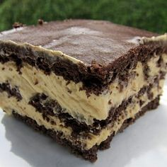 Peanut Butter Eclair Cake,  Need chocolate graham crackers, peanut butter, cool whip, vanillla pudding and chocolate frosting (I like whipped). Yup!