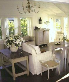 Cape Cod cottage style. White beachy living room. Cathedral cielings. Dark wood floors. Shabby chic. Distressed furniture.