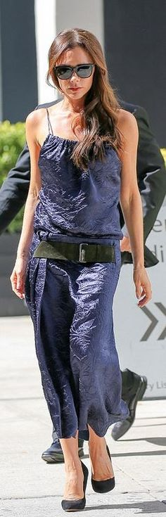 Who made Victoria Beckham's blue dress and black sunglasses?