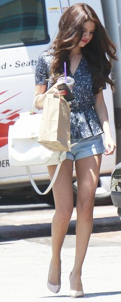 Selena Gomez in cute summer time top  shorts....