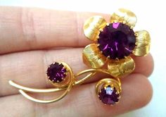 "Stunning Vintage Estate Gold Tone Purple Rhinestone Flower Brooch!!! 2594J FOR SALE • $0.99 • See Photos! Money Back Guarantee. This is a must have! It measures app. 2"". It is in great condition. Don't miss out on this fabulous piece! Hi, and welcome to(formerly jmirra412 Ebay user id) Relic 302139300796"