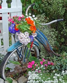 garden art ~ we are doing this with an old bike at my parents house ~ using ivy to cover and using the basket for flowers