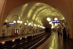 The Most Beautiful Metro Stations in Paris | WhyGo Paris   Cite Station on Metro Line 4              Not only does the Cité station – the only one on the Île de la Cité – have a beautiful art nouveau entrance, it also has pretty globe lighting along the track itself, reminiscent of old fashioned street lights.