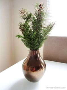 Christmas tree branches arranged in a vase.