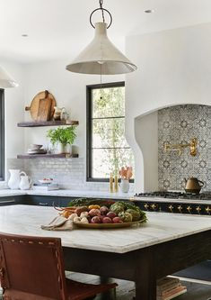 Wednesday Watch List A gorgeous Spanish inspired kitchen with white stucco range, printed tile, black window panes, marble island top, leather chairs and warm accents. Designed by Amber Interiors and photographed by Tessa Neustadt. Home Design, Interior Design, Luxury Interior, Interior Styling, Kitchen Interior, New Kitchen, Kitchen Ideas, Kitchen Cupboard, Kitchen Modern