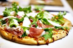 Prosciutto & arugula pizza- I think I would put the prosciutto on before baking and add a bunch more arugula.  And maybe some cherry tomatoes?