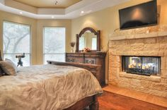 Bedroom with a fireplace.  http://cbharper.com/details-page.php?list_no=1103027