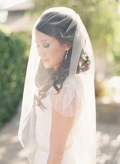 A blue and aqua + short sleeves wedding dress for a sophisticated garden wedding | Photo by Caroline Tran | Read more on sodazzling.com #gardenwedding #weddingblog