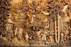 Kronid Gogolev is a genius Russian wood-carver who creates these incredible artworks inspired by the rural and provincial life of Russia's northern village.