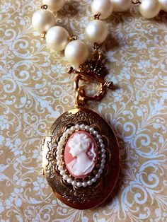 LOVE this cameo!!  BEST vintage jewelry...HANDS DOWN!!!! Vintage Cameo Locket Necklace on Etsy, $40.00