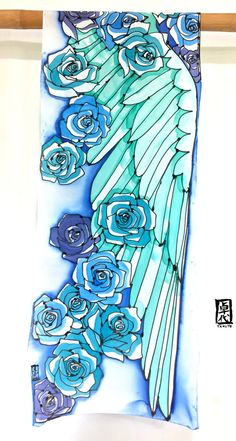 For the full Wing Scarf collection, visit us at: www.silktakuyo.com This is a large sized neck silk scarf with romantic Boho style blue and mint green wing design. The ocean shades of blue roses add allure and beauty. This mesmerizing hand painted silk scarf will add refreshing, bright colors to your fashion! The silk I used is Silk Crepe de Cine. It is an opaque silk with soft sanded texture. Silk Crepe illuminates back the light in a subtle way and is such a beautiful silk. I love Silk…