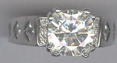 .55 carat princess cut diamonds, .73 carat round cut diamonds in 14 kt. white gold. Center is a cushion cut. WOW!!!!  www.facebook.com/middiajewelry  #engagementrings