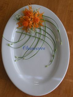 Carrot Flower Chai    This beautiful cut out pinwheel flowers are carve from carrot place on top of weaved chai blossom, it give this platter a unique look.