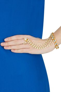 Kundan stones and multiple pearls beaded chain haath phool by Soranam.
