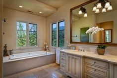 Traditional Master Bathroom with Master bathroom, Undermount sink, Wall sconce, European Cabinets, Inset cabinets, Stone Tile