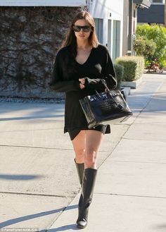 barely showing a possibly pregnant irina shayk stepped out in la wearing a slimming black