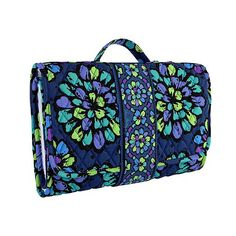 Changing Pad Clutch in Indigo Pop... best material out there! Vera Bradley process keeps her products looking good so everyday wear doesn't wear it out.