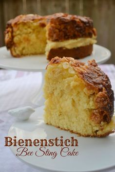 Bienenstich (Bee Sting Cake) Bun-like cake with a creamy custard filling and a caramelized almond topping.