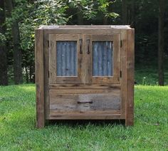 "& this is another ""don't know what I'd do with it, but I LOVE it"" — Rustic Vanity Reclaimed Barn Wood w/Tin Doors by Keeriah on Etsy"