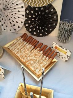 Candy coated pretzels at a white, black and gold baby shower party! See more party planning ideas at CatchMyParty.com!