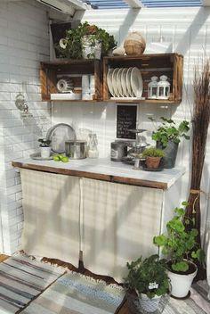 Estante con cajas de madera | Decorar tu casa es facilisimo.com