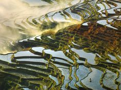 French photographer Thierry Bornier captures breathtaking landscape photos that highlight the rich splendor of China's mountains, rivers, and rice field terraces.