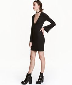 Check this out! Fitted dress in ribbed jersey with a low-cut V-neck at front and long sleeves with trumpet cuffs. - Visit hm.com to see more.