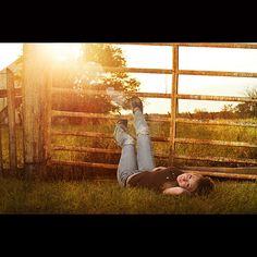 Taylor on the rusty farm gate