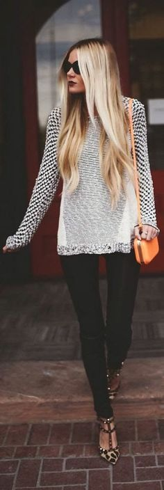 See more White and black lined sweater, black skinnies and cheetah print sandals
