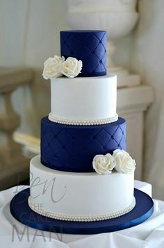 White & Navy Blue Wedding Cake with white flowers