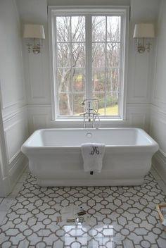 Loving this modern take on a vintage claw foot tub.