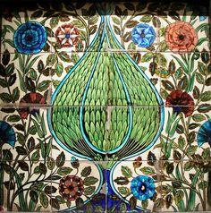Ornamental tile panel designed by William De Morgan.