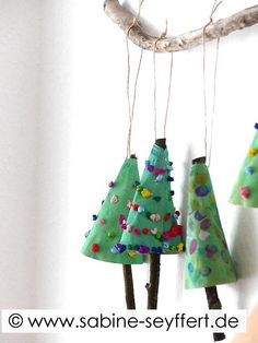 On Red Ted Art we have some adorable Coffee Filter Christmas Tree Ornaments for you to make! A super cute craft for Preschoolers this Christmas (though older kids will love them too). How cute!!! They work really well as Christmas Tree Ornaments or as Window Decorations. Love the Stick details!