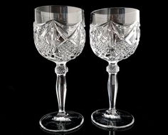 A set of two lead crystal white wine glasses. The glasses are handmade of thick lead crystal. Manufactured in West Germany. Height: 170 mm (6.69) Diameter at the top: 70 mm (2.76)  Total weight (2 glasses): ca. 600 g (1.32 lb)  Excellent vintage condition - no chips or cracks. Amazing quality!  Please take a moment to analyze the pictures for more details.   ******************************************************************************  Please check the shop policies. This will help to avoid…
