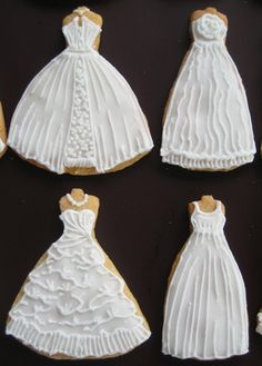 my spring 2010 wedding dress cookie collection. butter cookie with royal icing decor.this is something i've wanted to do for the longest time and i'm really happy that i finally did it!inspired by Sugar Envy's designer wedding dress cookie favours www.flickr.com/photos/sugarenvy/3340087454/