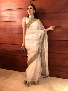 Net butti Saree with gold border with white silk blouse piece To purchase mail us at or Whatsapp us on 919833411702 White And Gold Saree, White Silk Blouse, White Saree, Red Saree, Sabyasachi Sarees, Indian Sarees, Anarkali, Lehenga, Bollywood Saree