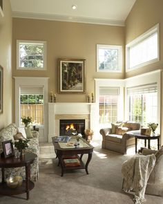 Two story living room; great window trim