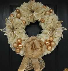 Cream deco mesh with hints of gold was used along with gorgeous gold poinsettias, ornaments and an amazing matching bow. Description from wreathchic.publishpath.com. I searched for this on bing.com/images