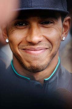 Lewis Hamilton talks to the press in the paddock