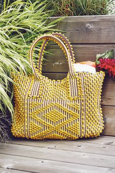 Antonello is a luxury, eco-conscious handbag collection designed in London and hand-crafted in Sardinia, Italy. The styles are produced in limited numbers and handwoven on looms using recycled and reg