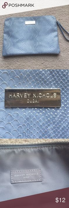 """Harvey Nichols wristlet/makeup bag Powder blue makeup bag from Harvey Nicols Dubai. Harvey Nichols is an upscale British department store similar to a Neiman Marcus. Logo says Harvey Nichols Dubai on outer hardware and inner tag. I received as a makeup bag but with the wrist strap and the cool blue python style, I think you could also use as a cute clutch. Approx 12 x 9"""". Never used. Harvey Nichols Bags Cosmetic Bags & Cases"""