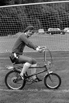 Ray Wilkins rides his Raleigh Chopper around Chelsea's training pitch, 1975