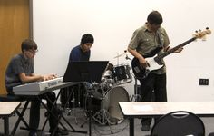 Trio of two students and their teacher from the Fort Hayes High School (Columbus) performed during lunch.