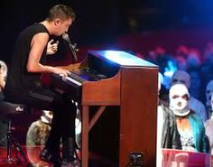2014 MTV Movie Awards- Tyler Joseph and Josh Dun from twenty one pilots perform Car Radio