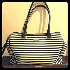 Kate Spade Black and White Kensington Tote large. Snappy stripes with twinned zip pockets for easy organization. Textile. Pink jacquard lining. Lobster clasp closure.Exterior zip pockets. Interior zip, wall and cell-phone kate spade Bags Totes