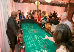 Create Vegas for your reception!  - photo by www.kevinmilz.com  -  http://ncweddingministerblog.blogspot.com/2013/03/will-and-brian-celebrate-love-and.html