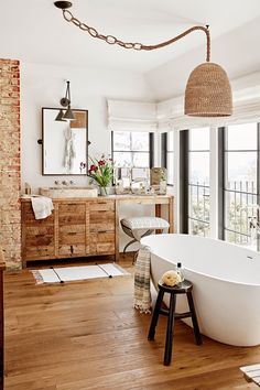 Warm bathroom uses a mix of exposed brick, wicker and natural wood in this home in Hollywood Hills, Ca. [2000 × 3000] : RoomPorn