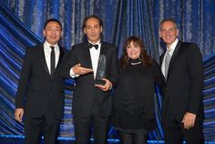 MAY 14, 2015 (L-R) Assistant Vice President, Film/TV Relations at BMI Ray Yee, honoree Alexandre Desplat, BMI Vice President of Film and Television Relations Doreen Ringer-Ross and BMI President and CEO Mike O'Neill pose with the BMI Icon Award onstage during the 2015 BMI Film & Television Awards at the Beverly Wilshire Hotel on May 13, 2015 in Beverly Hills, California. (Photo by Lester Cohen/Getty Images for BMI)