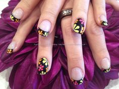 Black nails and French tips with pink orange and yellow free hand petite flowers floral nail art